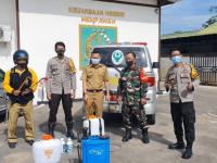 Koramil Mempawah Hilir Bersama Satgas PPKM Tingkat Kecamatan Laksanakan Penyemprotan Disinfektan