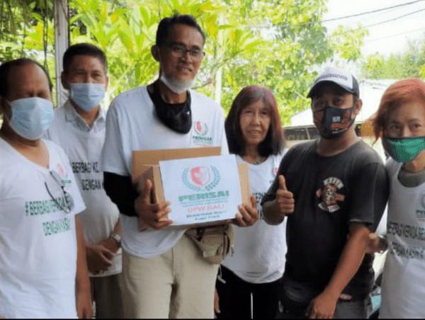 Perisai Bagikan Nasi Bungkus Merah Putih Untuk Warga Terdampak PPKM di Bali